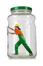 Man in coveralls imprisoned glass jar Stock Images