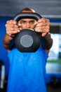 Man covering face with kettlebell Royalty Free Stock Photo