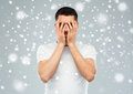 Man covering his face with hands over snow Royalty Free Stock Photo