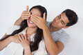 Man covering his pretty girlfriends eyes on white background Royalty Free Stock Photos