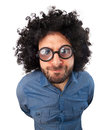 Man with crazy expression and puffy hair on white background Royalty Free Stock Image