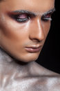 Man in creative make up with glitter and eyelashes Royalty Free Stock Photo