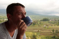 The man with a cup of coffee portrait drinking outdoors rice terraces bali Stock Photography