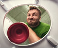 Man with cup plunger Royalty Free Stock Photo