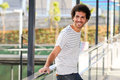 Man curly hairstyle smiling in urban background Stock Photography