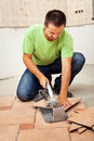 Man cutting ceramic floor tiles Stock Photography