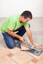 Man cutting floor tiles with manual cutter device Royalty Free Stock Images