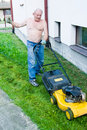 Man cutting grass with the mower Stock Image