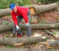 Man cutting log into sections Royalty Free Stock Photo