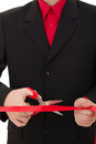 Man cutting the red ribbon with scissors Stock Images