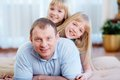 Man with daughters portrait of happy men twin looking at camera Stock Photography