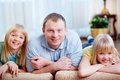 Man with daughters portrait of happy men twin looking at camera Stock Images
