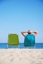 Man on deckchair at the beach Royalty Free Stock Photos