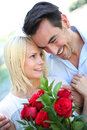 Man declaring his love with red roses giving to woman Stock Photo
