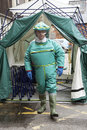 Man in decontamination suit exiting a tent Royalty Free Stock Photo