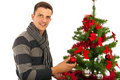 Man decorate christmas tree happy isolated on white background Royalty Free Stock Photos