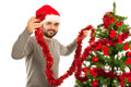 Man decorate christmas tree in red and silver colors Stock Photos