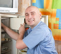 Man  defrosting the refrigerator Royalty Free Stock Photo