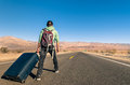 Man in the desert with luggage death valley california walking Royalty Free Stock Images