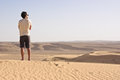 Man in the desert standing alone an empty Royalty Free Stock Image