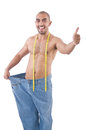 Man in dieting concept with oversized jeans Stock Images