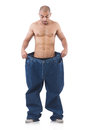 Man in dieting concept with oversized jeans Royalty Free Stock Photography