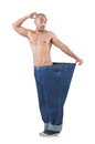 Man in dieting concept with oversized jeans Royalty Free Stock Photos
