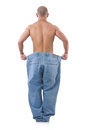 Man in dieting concept with oversized jeans Stock Image