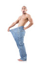 Man in dieting concept with oversized jeans Royalty Free Stock Image