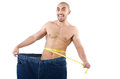 Man in dieting concept with oversized jeans Stock Photos