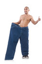 Man in dieting concept with oversized jeans Stock Photo