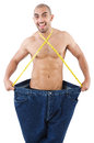 Man in dieting concept with oversized jeans Royalty Free Stock Images