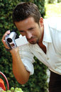 Man with digital camera video Stock Images
