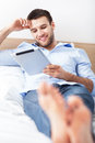 Man with digital tablet relaxing Royalty Free Stock Photo