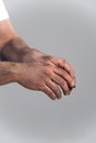 Man with dirty hands on grey background. Royalty Free Stock Photo