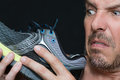 Man Disgusted By Shoes Smell Royalty Free Stock Photo