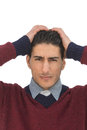 Man in distress a putting his hands on his head with a worried look on his face Royalty Free Stock Photos