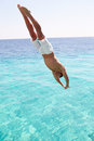 Man diving blue sea Stock Images