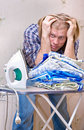 Man does not want ironing clothes Stock Photography