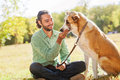 Man and dog central asian shepherd walk in the park he keeps the on the leash Stock Photography