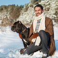 Man and dog friendship forever a in a winter forest with cane corso Stock Photo