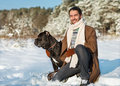 Man and dog friendship forever a in a winter forest with cane corso Stock Image