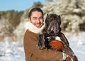 Man and dog friendship forever a in a winter forest with cane corso Royalty Free Stock Image
