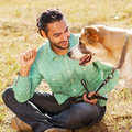 Man and dog in park central asian shepherd walk the he keeps the on the leash Stock Photography