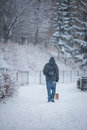Man And Dog In Snow