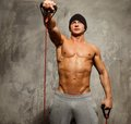 Man doing fitness exercise handsome with muscular body Stock Photos