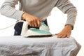 Man doing housework an asian ironing shirt on white background Stock Image