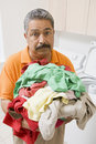 Man Doing Laundry Stock Photography