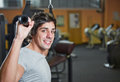 Man doing pulldowns in fitness Stock Photography