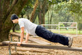 Man Doing Push-Ups on Bench in Park - Horizontal Royalty Free Stock Photo
